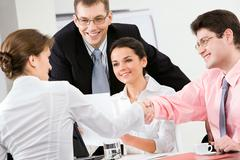 Handshake in the office Stock Photos