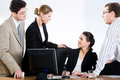 business people are discussing questions at meeting - stock photo