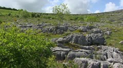 Pan + hold  karst hills with limestone pavements in the Burren. - stock footage
