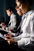 Portrait of business people writing a text at seminar in the evening Stock Photos