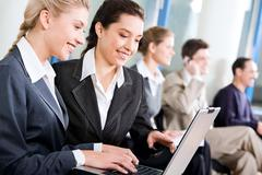 confident women are working on the background of business people - stock photo