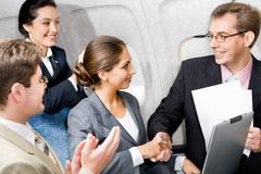 business people shaking hands making an agreement in the plane - stock photo