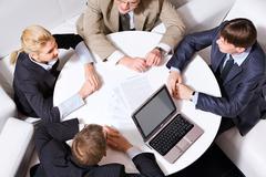 Handshake at meeting - stock photo