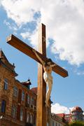 crucified on a wooden cross - stock photo