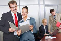 business woman is showing her successful business plan to a colleague in the off - stock photo