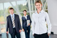successful woman putting her hands into the pocket on the background of  busines - stock photo