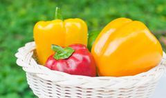 fresh sweet  paprika in wood basket - stock photo
