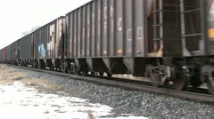 Railroad cars passing winter rural community HD 5031 Stock Footage