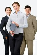 photo of beautiful female leader on the background of her business team - stock photo
