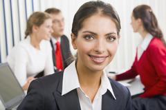 successful young woman with charming confident smile on the background of her co - stock photo