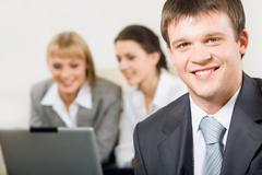 Portrait of confident professional looking at camera in a working environment Stock Photos