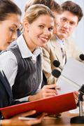 Stock Photo of portrait of successful young woman between her colleagues