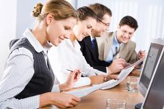 Stock Photo of photo of business people reading a text in the classroom
