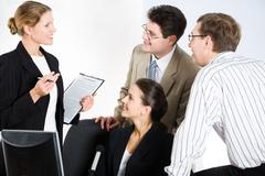 photo of successful professionals interacting with each other - stock photo