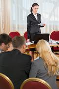 portrait of business woman  pronouncing a speech in conference room - stock photo