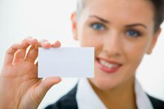 Image of  woman holding her visiting card Stock Photos