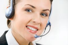 face of charming confident woman with headset - stock photo