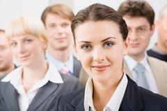 photo of female leader with her business team - stock photo