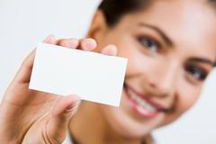 close-up of  professional's white business card - stock photo