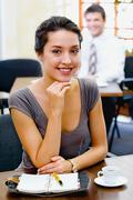 Portrait of a confident business woman with charming smile in the cafe Stock Photos