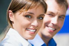 Face of business woman with charming confident smile on the background colleague Stock Photos