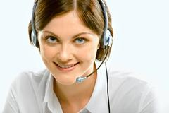 portrait of attractive customer support service with fascinating smile - stock photo