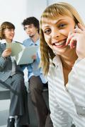 business secretary is speaking by the phone in the office - stock photo
