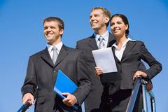 team of business people on the background of blue sky - stock photo