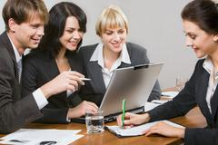contemporary business people working together in the office - stock photo