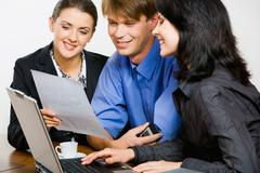 confident professional demonstrates new strategy to her co-workers - stock photo