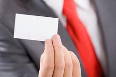 Close-up of male hand holding a business card Stock Photos