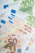 close-up of fifty and hundred euro banknotes in a row - stock photo