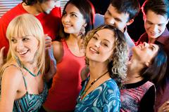 Portrait of happy people interacting at a evening-party Stock Photos