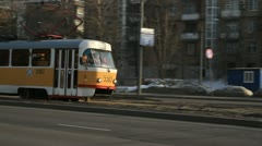 Tram turning left on road in Moscow Stock Footage