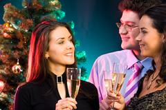Portrait of smiling young people chatting at christmas Stock Photos