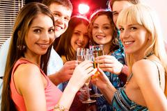 portrait of group of smiling young people enjoying cocktails - stock photo