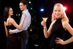 Portrait of charming woman holding cocktail on the background of dancing couple Stock Photos