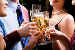 image of human hands holding the glasses of champagne making a toast - stock photo