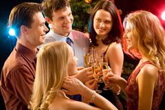 Photo of five smiling friends touching their glasses with each other at christma Stock Photos