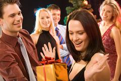 Photo of man giving to pretty woman the present at christmas Stock Photos