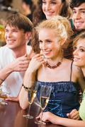 wonderful picture: happy people looking at a barman - stock photo