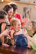 Image of  an interaction of young happy people in a bar Stock Photos