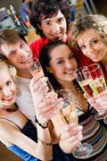 group of young people enjoying cocktails - stock photo