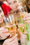 close-up of a wineglasses in a celebration clink - stock photo