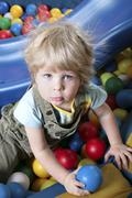 Cute boy in playing area - stock photo