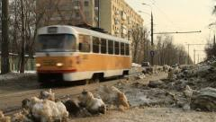 Yellow tram running on tramway Stock Footage