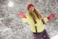 Image of attractive young woman flinging the snowball Stock Photos