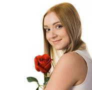 smiling lady with red rose looking at camera over white background - stock photo