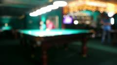 Playing russian billiard in a poolroom, defocused Stock Footage
