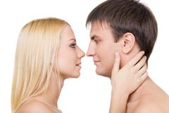 profiles of two lovers before kissing each other isolated on white background - stock photo